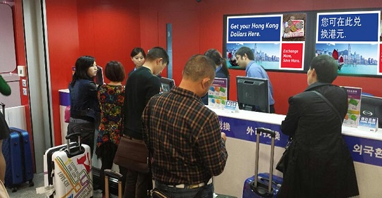 Exchanging currency at Travelex Hong Kong